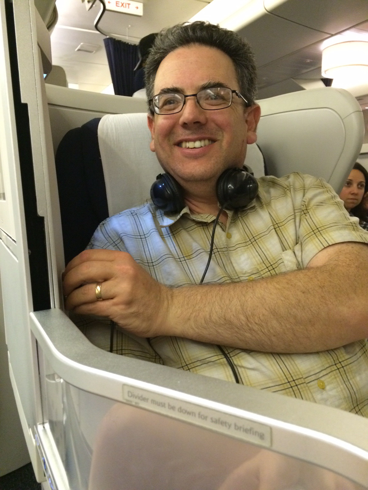 Grinning like a madman in the too comfortable business class seat.